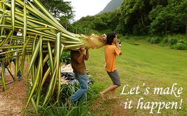 two men carrying a giant plant with the words, 'Let's make it happen!'